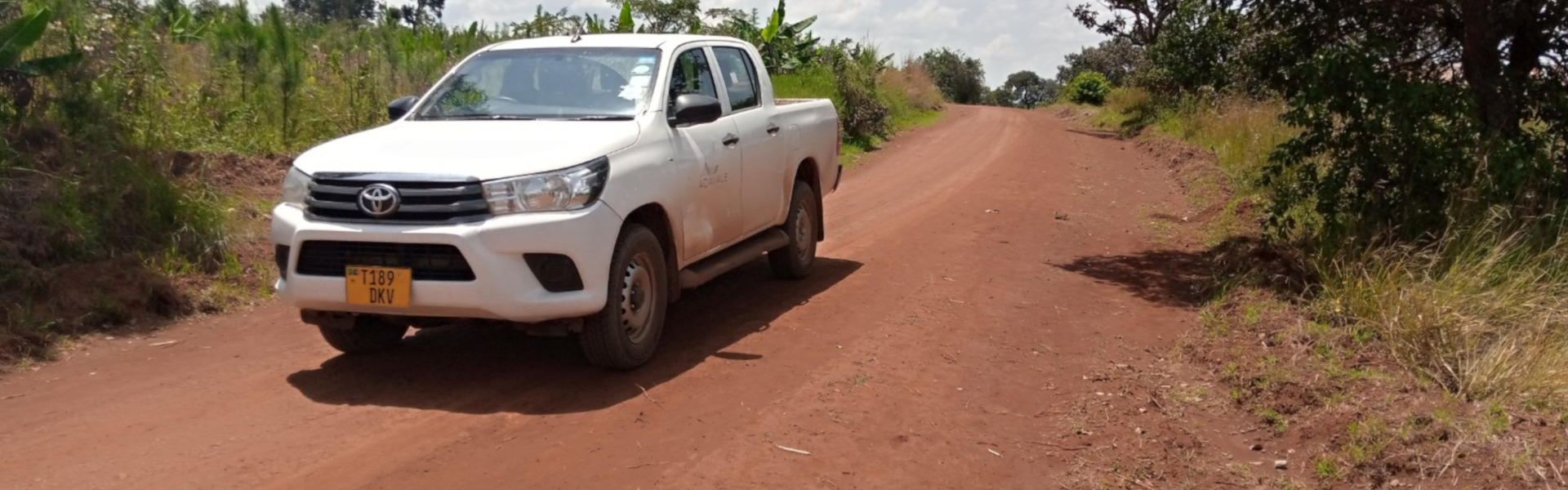 White mining exploration truck on a dirt road in Tanzania